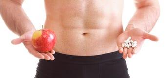 Vitamin oder Pillenwiderstandtablette packt lokalisierten Ergänzungen Mann ein Lizenzfreies Stockfoto