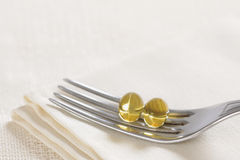 Vitamin oil capsules. Close up Stock Image