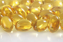 Vitamin oil capsules. Close up Stock Photos