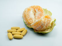 Vitamin and orange on white background. Isolate Stock Photo