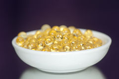 Vitamin-Pillen (A, D, E, Fisch-Öl) Lizenzfreie Stockfotografie