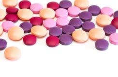 Vitamin pills. Multicolored vitamin pills isolated on white background Stock Photos