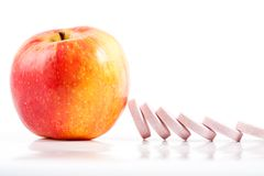 Vitamin pills dominoes, stopped by apple Stock Photo