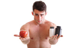 Vitamin or pills drag tablet boxes supplements Man isolated. Natural apple vitamin or pill drag tablet Man isolated offering apple in one and pills in bottle stock images
