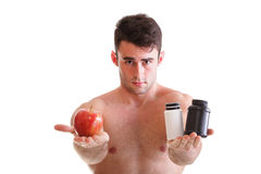 Vitamin or pills drag tablet boxes supplements Man isolated. Natural apple vitamin or pill drag tablet Man isolated offering pill in one and pills in bottle - in stock photo