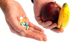 Vitamin pills or a healthy diet? Stock Image