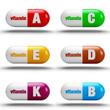 Vitamin pills. Isolated on white background Stock Photos