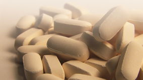 Vitamin Pills Rotating on White Royalty Free Stock Images