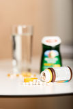 Vitamin pills on table assorted Royalty Free Stock Photo