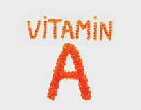 Vitamin A of red caviar. Red salmon caviar in the shape of phrases vitamin A Royalty Free Stock Photos