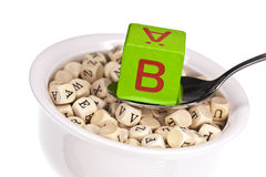 Vitamin-rich alphabet soup featuring vitamin b. Isolated on a white background Stock Images