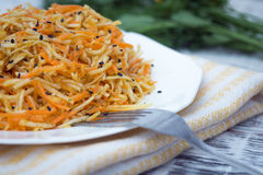 Vitamin salad with celery root, carrots and apples. Vitamin salad with celery root, carrots and apples Stock Photography