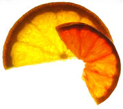 Vitamin slices. Slice of red and regular orange royalty free stock images