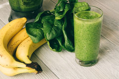 Vitamin Smoothies in a glass on a wooden table Royalty Free Stock Photo