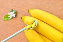 Vitamin tablet on banana Royalty Free Stock Image
