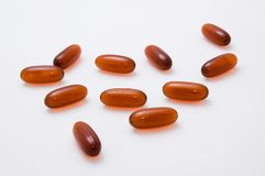 Vitamin tablets and capsules Stock Photos