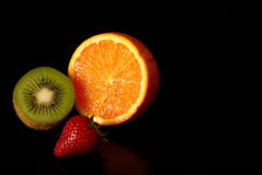 The Vitamin Three. Arrangement of fresh fruit with copy space on the right Royalty Free Stock Images