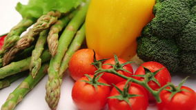 Vitamin vegetable collection tomatoes with a branch, tomatoes cherry, sweet yellow pepper, aspargus, chili pepper stock video