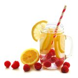 Vitamin water with lemon and raspberries in mason jar. Healthy vitamin water with lemon and raspberries in a mason jar over a white background Stock Photography