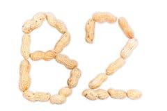 Vitamina B2 dos amendoins isolados no fundo branco Fotografia de Stock Royalty Free