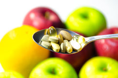 Vitamina na colher Imagem de Stock Royalty Free