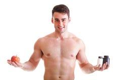 A vitamina ou a tabuleta do arrasto dos comprimidos encaixotam o homem dos suplementos isolado Imagens de Stock