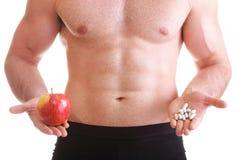 A vitamina ou a tabuleta do arrasto dos comprimidos encaixotam o homem dos suplementos isolado Fotografia de Stock