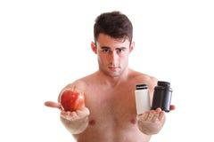 A vitamina ou a tabuleta do arrasto dos comprimidos encaixotam o homem dos suplementos isolado Foto de Stock