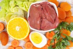 Vitamina A que contiene de la consumición nutritiva, nutrición sana como minerales de la fuente imagen de archivo libre de regalías