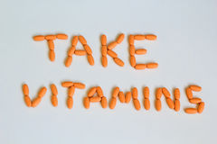 Vitaminas da tomada Foto de Stock Royalty Free