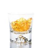 Vitaminas Omega-3 en vidrio foto de archivo libre de regalías
