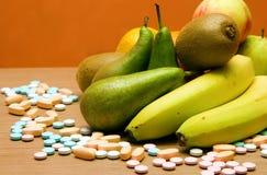 Vitaminas ou frutas? Foto de Stock Royalty Free