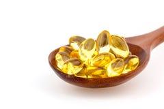 Vitaminas para el tratamiento en la división médica Imagen de archivo libre de regalías
