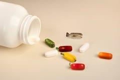 Vitaminas que muestran los ingredientes sanos naturales Foto de archivo