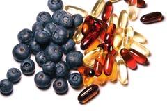 Vitaminas y arándanos Imagen de archivo libre de regalías