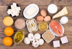 Vitamine D food sources, top view on wooden background. Vitamine D food sources such as fish, dairy and healthy fats, top view on wooden background Stock Images