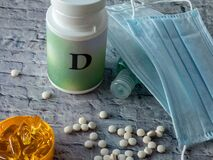 Free Vitamine D Tablets Near Plastic Conainer And Medical Face Masks On The Table Stock Photography - 197811862
