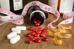 Vitamine für dünnes Pillenkonzept stockfotografie