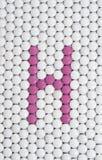 Vitamine H van pillsv wordt gemaakt die Royalty-vrije Stock Afbeeldingen