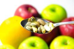 Vitamine op de lepel Royalty-vrije Stock Afbeelding
