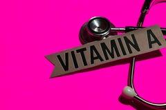 Vitamine A op het document met gezondheidszorg voor bejaarden-Concept stock fotografie