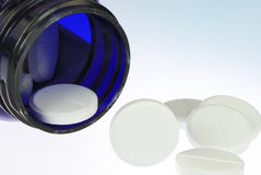 Vitamine pills. In a blue glass Royalty Free Stock Photography