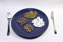 Vitamine und Ergänzungen stockfotografie