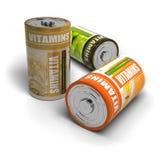 Vitamines et énergie d'isolement au-dessus du blanc Image libre de droits
