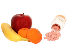 Vitamines - naturelles contre artificiel Images stock