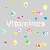 Vitamines word surrounded with pills and tablets Royalty Free Stock Photo