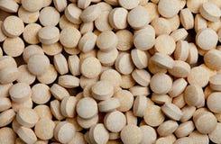 Vitaminpillehintergrund Stockfoto