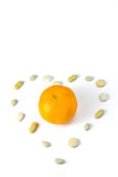 Vitamins. Fresh orange surrounded by vitamins Stock Images