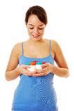 Vitamins. Woman holding containers of vitamins Stock Photos