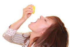 Vitamins. Young beautiful woman with half of lemon isolated on white - vitamins Royalty Free Stock Images